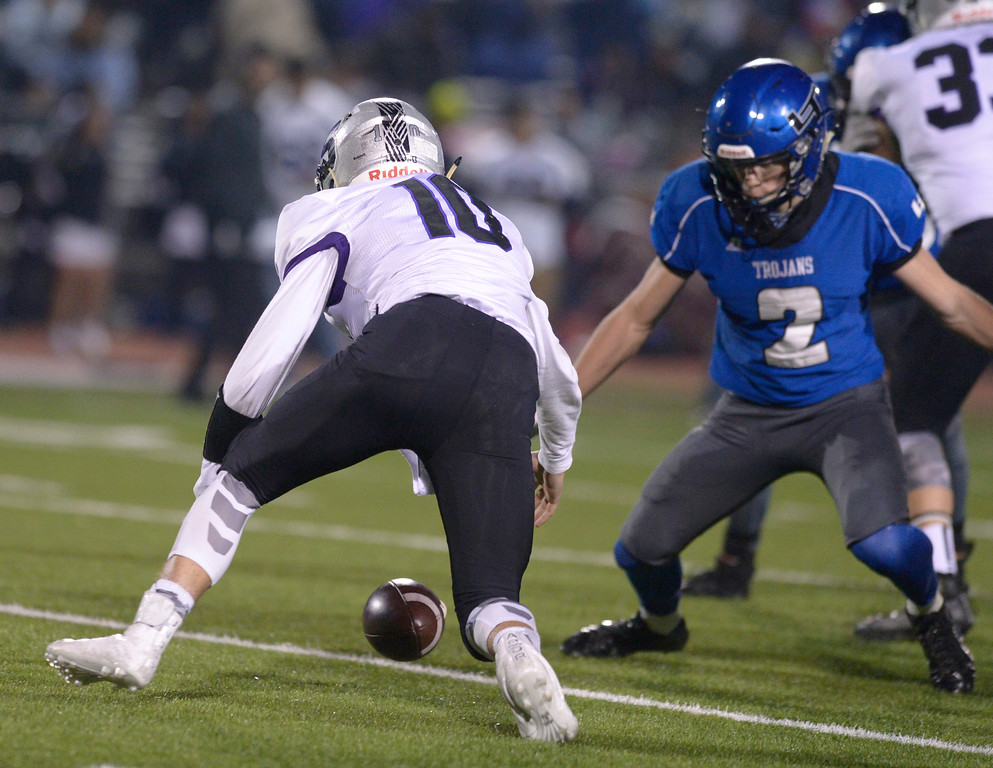 . Skyview\'s Nichael Vigil fumbles the in the second quarter Friday night at Everly-Montgomery Field. The ball was picked up by Longmont\'s Mathew Sprecher and carried in for a touchdown. To view more photos visit bocopreps.com. Lewis Geyer/Staff Photographer Nov. 10, 2017
