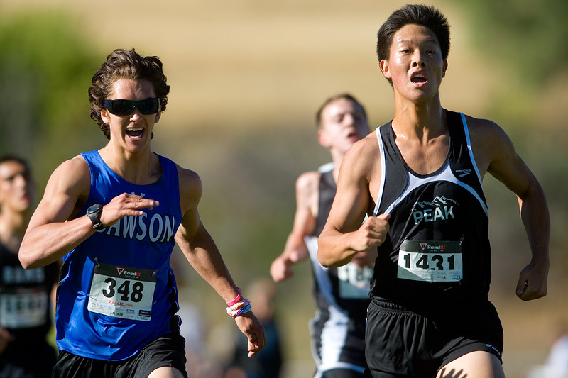 "John Paquette, of Alexander Dawson School, and Jay Kang, of Peak to Peak Charter School, cross the finish line during the St. Vrain Invitational Cross Country Meet at Lyons Middle/Senior High School in Lyons on Saturday. <br /> More photos:  <a href=""http://www.BoCoPreps.com"">http://www.BoCoPreps.com</a><br /> (Autumn Parry/Staff Photographer)<br /> September 10, 2016"