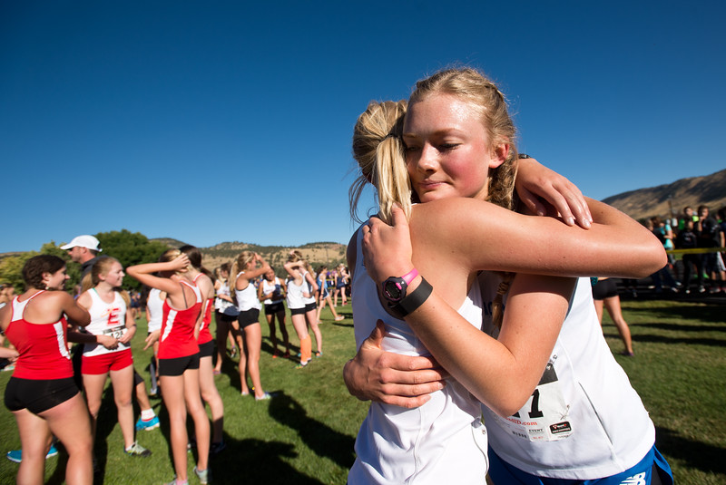 "Addy Ouweneel (left) hugs Keturah Jones, of Longmont High School, after running in the St. Vrain Invitational Cross Country Meet at Lyons Middle/Senior High School in Lyons on Saturday. <br /> More photos:  <a href=""http://www.BoCoPreps.com"">http://www.BoCoPreps.com</a><br /> (Autumn Parry/Staff Photographer)<br /> September 10, 2016"