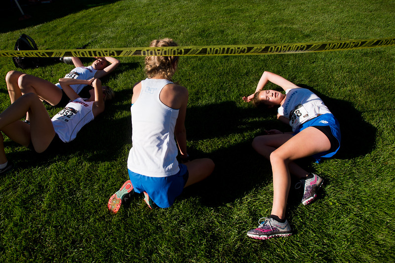 "Emily Billow (right), of Longmont High School, lays on the ground after running in the St. Vrain Invitational Cross Country Meet at Lyons Middle/Senior High School in Lyons on Saturday. <br /> More photos:  <a href=""http://www.BoCoPreps.com"">http://www.BoCoPreps.com</a><br /> (Autumn Parry/Staff Photographer)<br /> September 10, 2016"