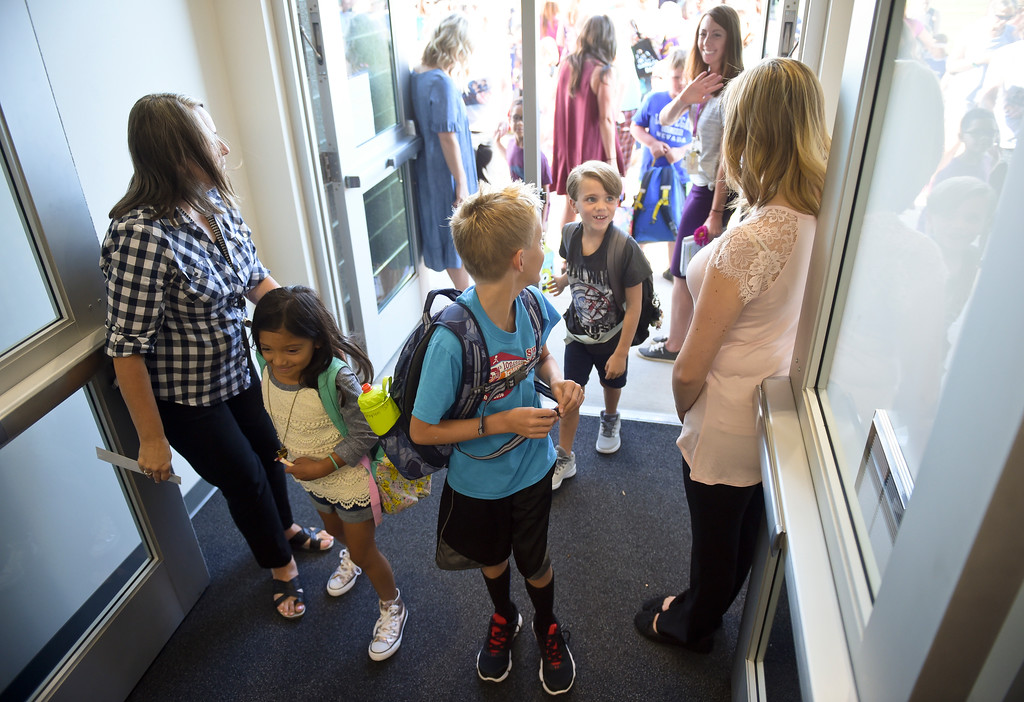 . Students walk into school on the first day of the new school year at Eagle Crest Elementary, 4444 Clover Basin Dr. Tuesday morning. To view more photos visit timescall.com. Lewis Geyer/Staff Photographer August 15, 2017