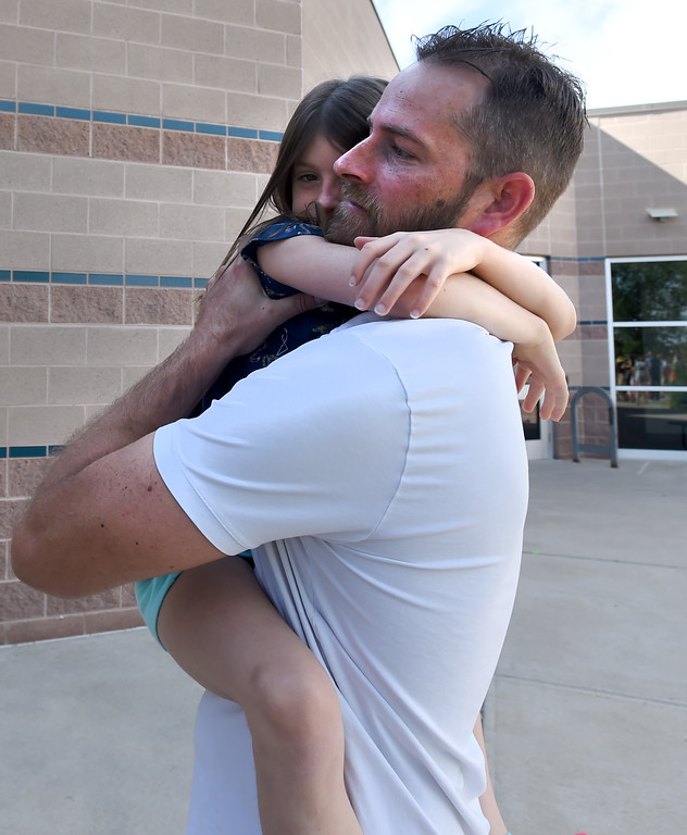 . Dylan Wolvington hugs her dad, Matt, as they say goodbye, during the first day of school at Blue Mountain Elementary in Longmont  in the St. Vrain Valley School District on Tuesday. For more photos, go to dailycamera.com.  Cliff Grassmick  Staff Photographer August 15, 2017