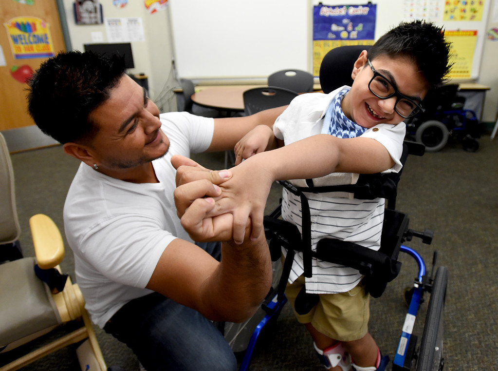 . Arath Estrada, a second-grader, gives his father, Hector, a high-five as he says goodbye during the first day of school at Blue Mountain Elementary  in the St. Vrain Valley School District on Tuesday. For more photos, go to dailycamera.com.  Cliff Grassmick  Staff Photographer August 15, 2017