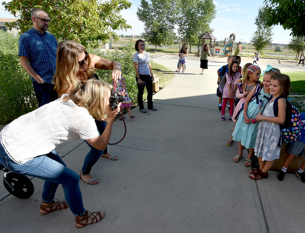 . Courtney Ballagh, left, and Kristy Berger, take photos of the second graders before they go into their classroom during the first day of school at Blue Mountain Elementary in Longmont  in the St. Vrain Valley School District on Tuesday. For more photos, go to dailycamera.com.  Cliff Grassmick  Staff Photographer August 15, 2017