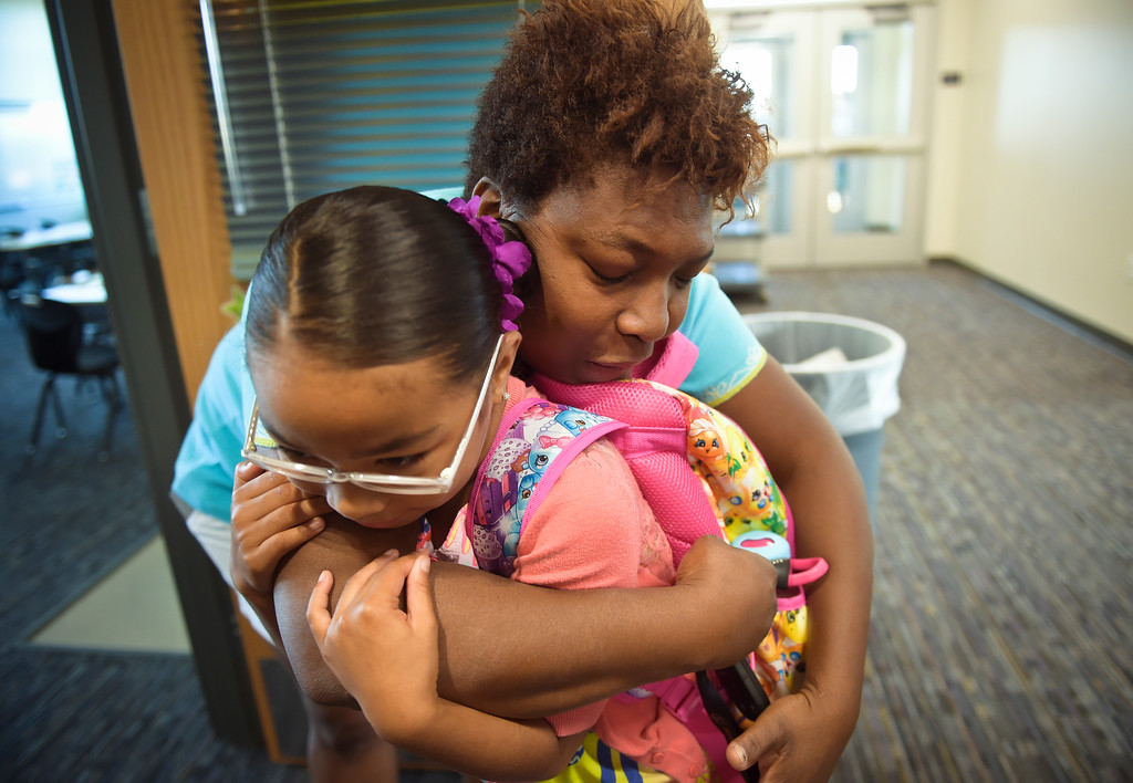 . Second grader Tristain White, 7, gets a hug from her mother Charmaine White before classes start on the first day of school at Eagle Crest Elementary, 4444 Clover Basin Dr. Tuesday morning. To view more photos visit timescall.com. Lewis Geyer/Staff Photographer August 15, 2017