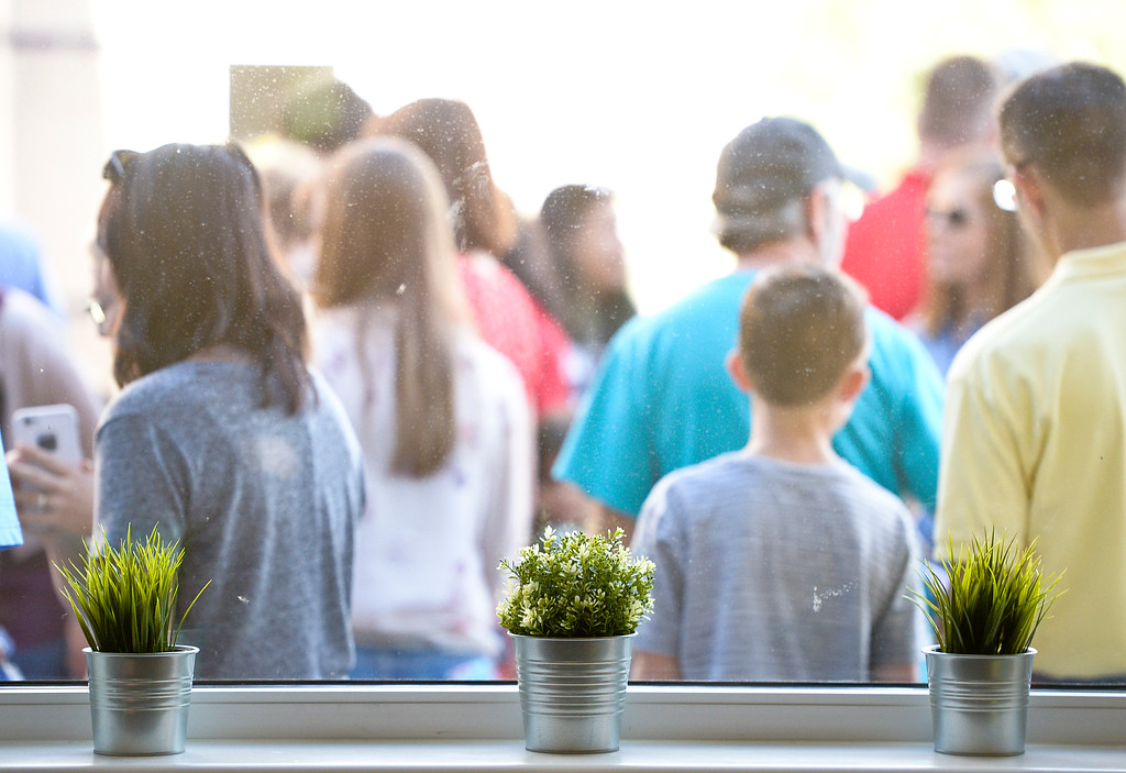 . Parents and students wait outside before classes start on the first day of school at Eagle Crest Elementary, 4444 Clover Basin Dr. Tuesday morning. To view more photos visit timescall.com. Lewis Geyer/Staff Photographer August 15, 2017