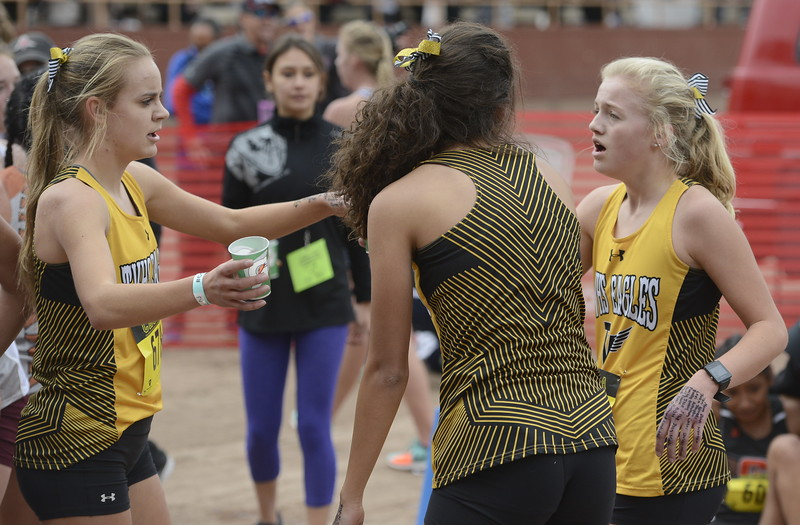 Thompson Valley's Kenadi Krueger, left, embraces Victoria Kavvadas, middle, next to Madzie Boyles on Saturday in Colorado Springs.