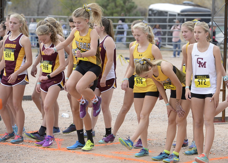 Thompson Valley's Gracy Roitsch, middle, gets ready to run the 4A girls state cross country championship on Saturday in Colorado Springs.