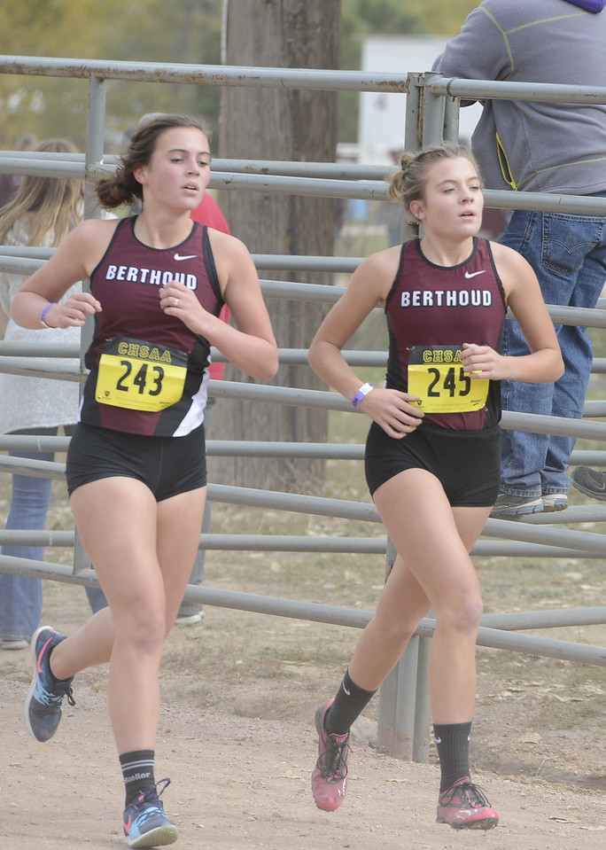 Berthoud's Julianne Evans Dennison (243) and Alex Schultz (254) run in the 3A girls state cross country championship on Saturday in Colorado Springs.