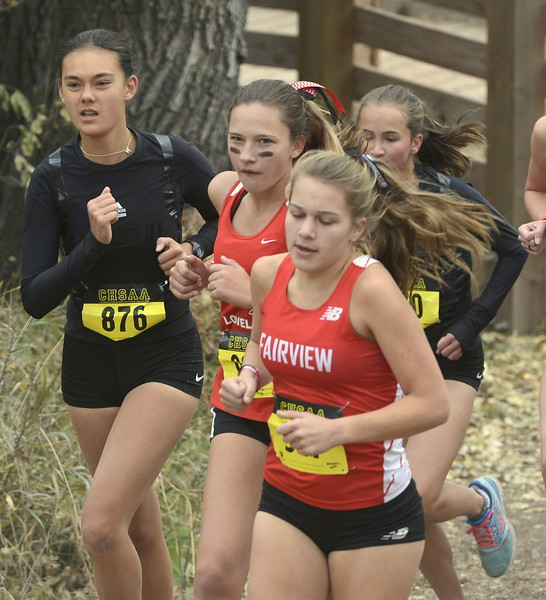 Loveland's Mckenzie Lindgren, middle, runs in the 5A girls state cross country championship on Saturday in Colorado Springs.