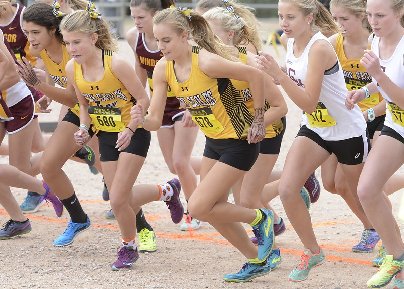 Kenadi Krueger (678) and Gracy Roitsch (680) begin the 4A girls state championship race on Saturday in Colorado Springs.
