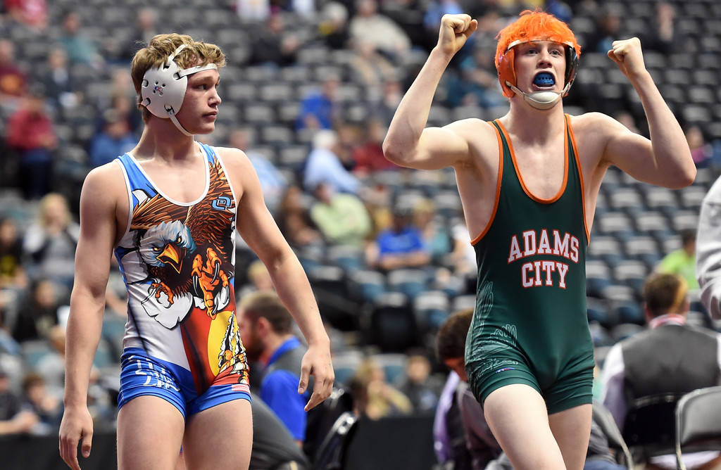 . Preston Renner, left, of Broomfield, loses to Gavin Deaquero, of Adams City,during the Colorado Wrestling State Championships finals on February 18, 2017. For more photos, go to www.BoCoPreps.com. Cliff Grassmick / Staff Photographer / February 18, 2017