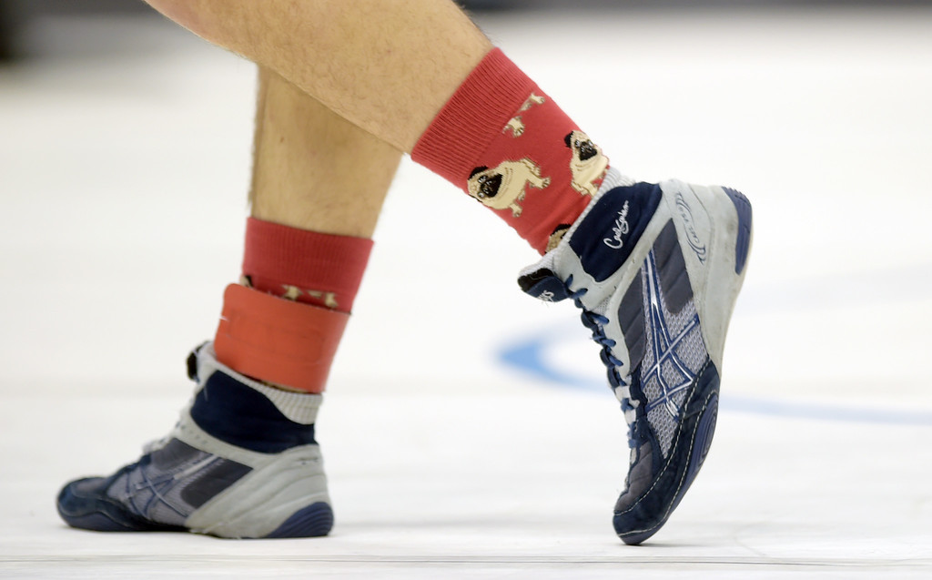 . Longmont High 152 pound wrestler Nathan Morris wears special socks for his championship match during the state wrestling tournament at the Pepsi Center Saturday. To view more photos visit bocopreps.com. Lewis Geyer/Staff Photographer Feb. 18, 2017