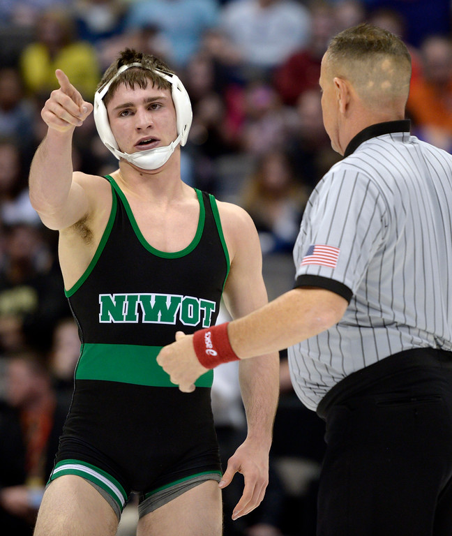 . Niwot\'s Tommy Stager celebrates his win in the 4A 145 pound championship during the state wrestling tournament at the Pepsi Center Saturday. To view more photos visit bocopreps.com. Lewis Geyer/Staff Photographer Feb. 18, 2017