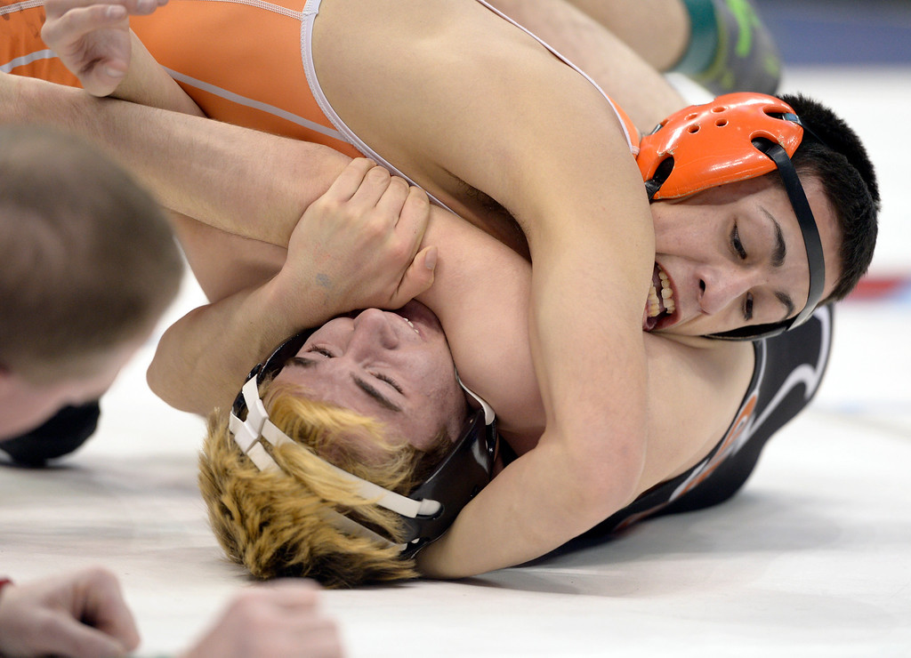 . Mead\'s Jeremy Ashton is controlled by Greeley Central\'s Zeke Alirez in their 4A 132 pound match for third place during the state wrestling tournament at the Pepsi Center Saturday. To view more photos visit bocopreps.com. Lewis Geyer/Staff Photographer Feb. 18, 2017