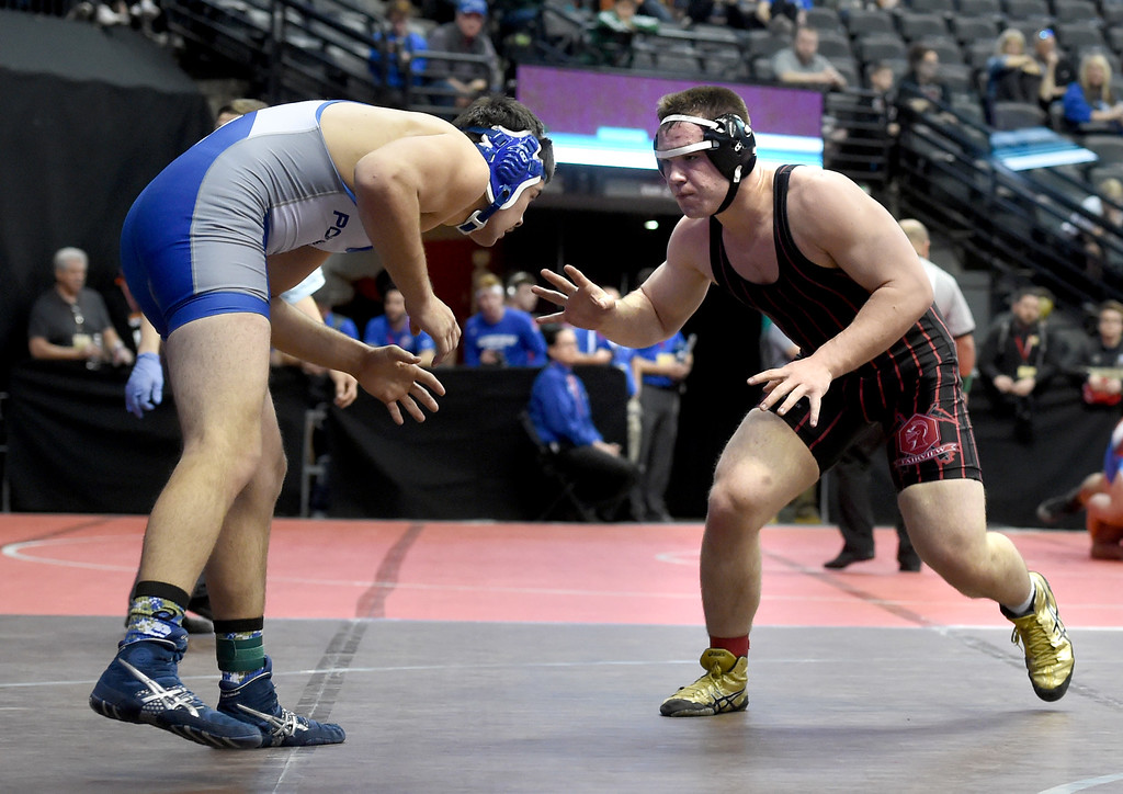 . Duncan Heath, right, of Fairview, takes on Cole Yung, of Poudre at 195-pounds,during the Colorado Wrestling State Championships finals on February 18, 2017. For more photos, go to www.BoCoPreps.com. Cliff Grassmick / Staff Photographer / February 18, 2017
