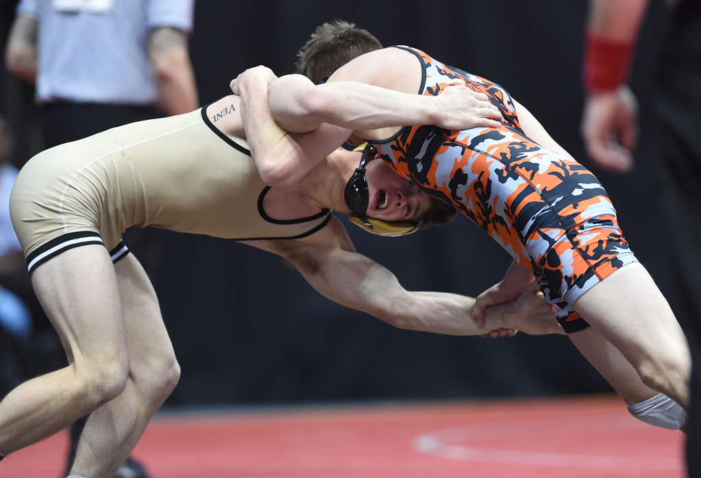 . Cole Polluconi, left, of Monarch, takes on Tyren Castonguay, of Grand Junction, during the Colorado Wrestling State Championships finals on February 18, 2017. For more photos, go to www.BoCoPreps.com. Cliff Grassmick / Staff Photographer / February 18, 2017