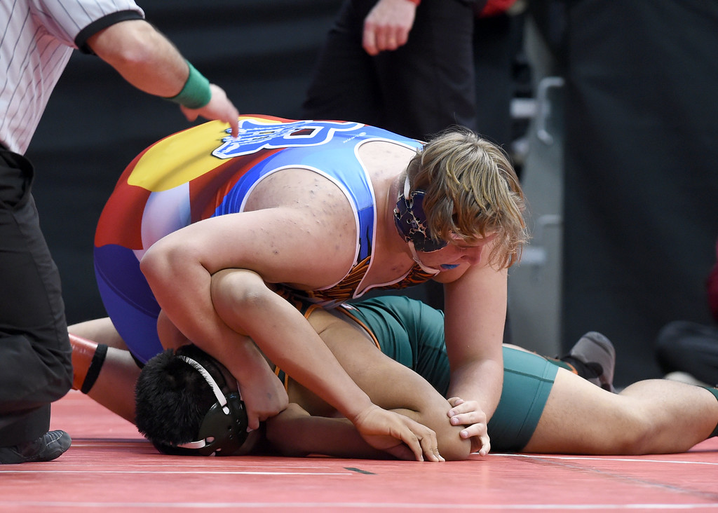. Mason Watt, top, of Broomfield, takes on Arnulfo Alvarado, during the Colorado Wrestling State Championships finals on February 18, 2017. For more photos, go to www.BoCoPreps.com. Cliff Grassmick / Staff Photographer / February 18, 2017