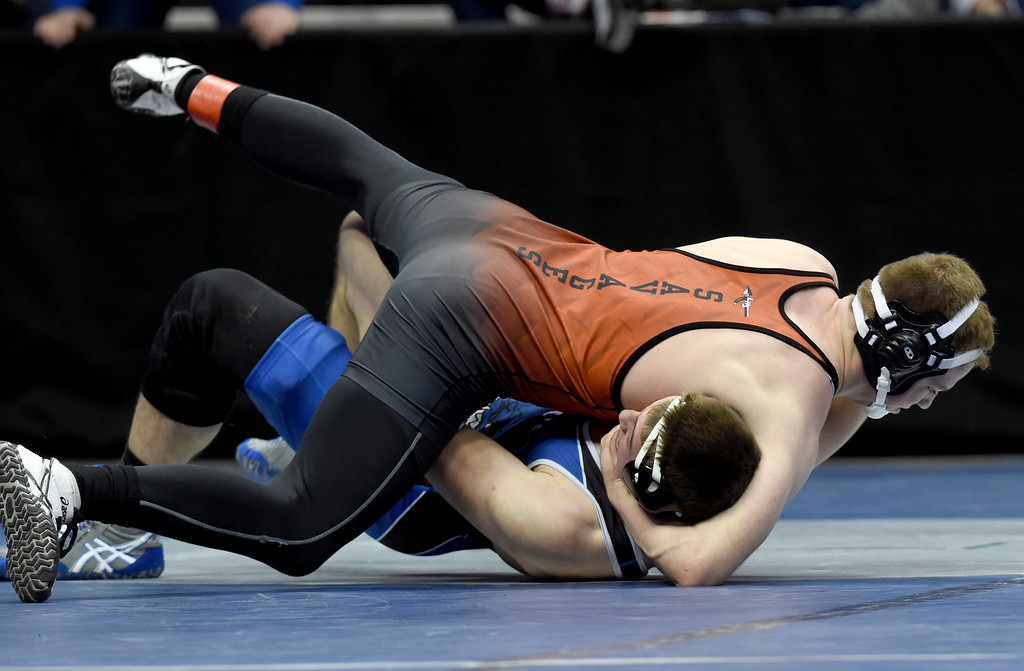 . Colton Eberhardt, of Lamar, top, takes on Elias Peroulis, of Moffat County, during the Colorado Wrestling State Championships finals on February 18, 2017. For more photos, go to www.BoCoPreps.com. Cliff Grassmick / Staff Photographer / February 18, 2017