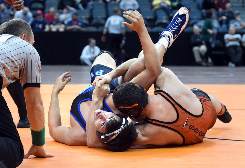 . Lamar\'s Ethan Andrade, right, takes on Presiliamo Maez, of Sheridan, at 3A 120-pounds, during the Colorado Wrestling State Championships finals on February 18, 2017. For more photos, go to www.BoCoPreps.com. Cliff Grassmick / Staff Photographer / February 18, 2017