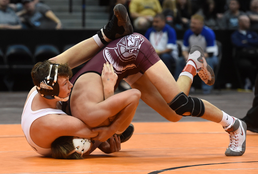 . Brandon, left, of Holy Family,  takes on Bailey, of Berthoud, during the Colorado Wrestling State Championships finals on February 18, 2017. For more photos, go to www.BoCoPreps.com. Cliff Grassmick / Staff Photographer / February 18, 2017