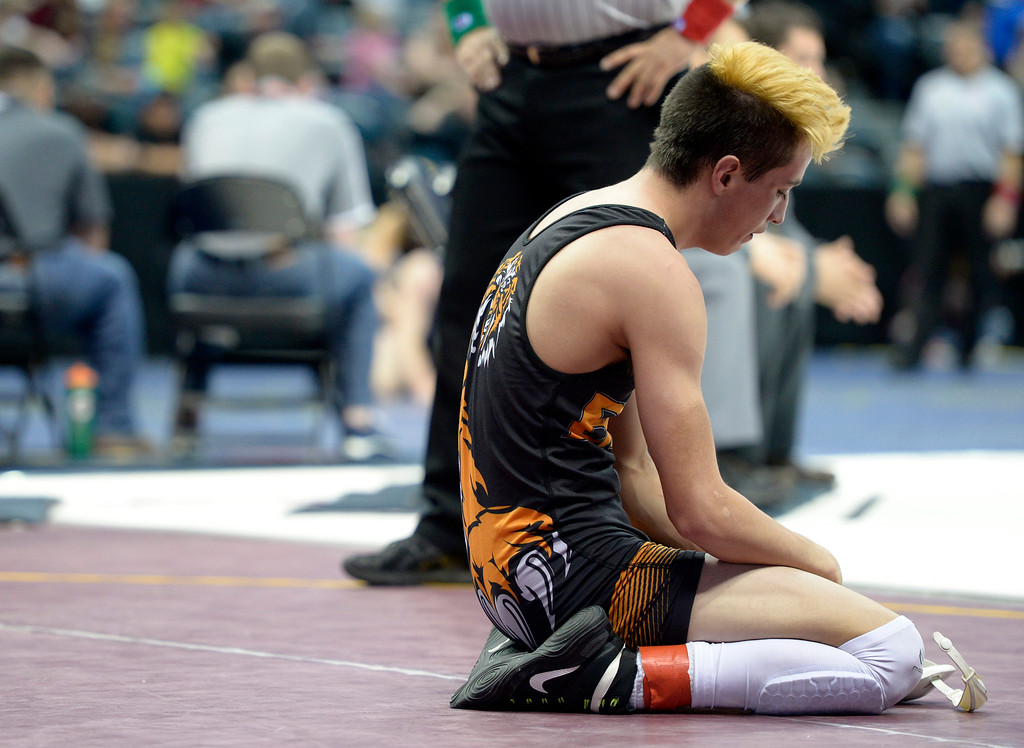 . Erie\'s Ernie Quintana pauses after losing to Discovery Canyon\'s Jared Turner in their 5th place 4A 138 pound match during the state wrestling tournament at the Pepsi Center Saturday. Quintana lost. To view more photos visit bocopreps.com. Lewis Geyer/Staff Photographer Feb. 18, 2017