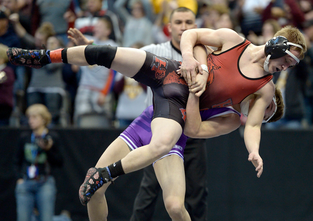 . Holly\'s Brendyn Nordyke is tossed to the ground during his loss to John Mall\'s Wesley Vanmatre in the 2A 120 pound championship match during the state wrestling tournament at the Pepsi Center Saturday. To view more photos visit bocopreps.com. Lewis Geyer/Staff Photographer Feb. 18, 2017