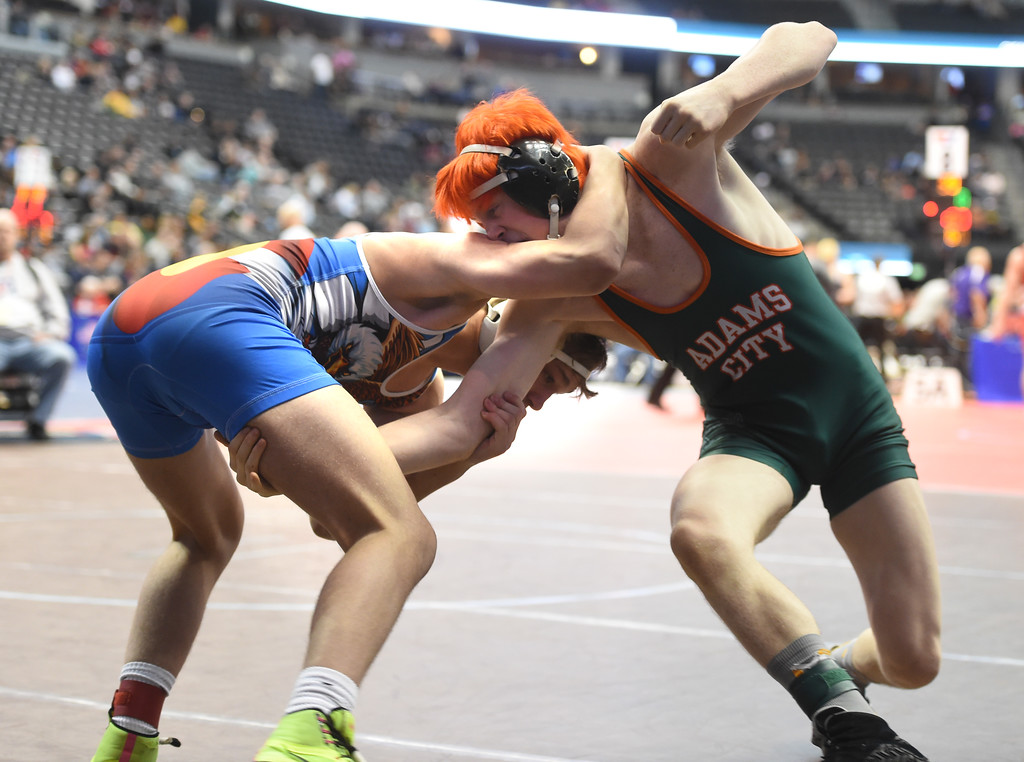 . Preston Renner, left, of Broomfield, takes on Gavin Deaquero, of Adams City, during the Colorado Wrestling State Championships finals on February 18, 2017. For more photos, go to www.BoCoPreps.com. Cliff Grassmick / Staff Photographer / February 18, 2017