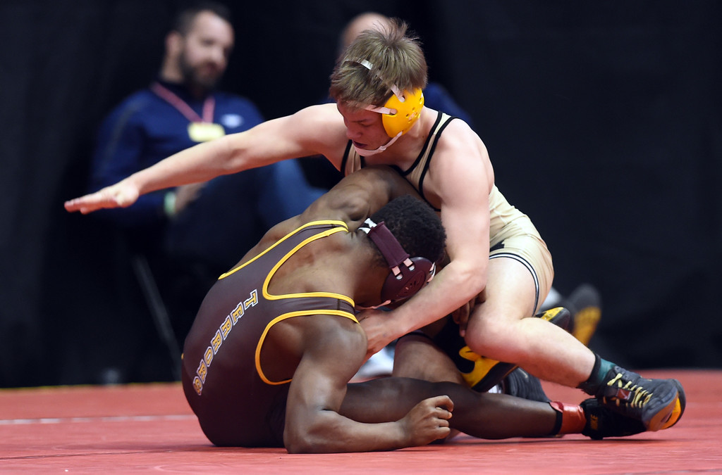 . Xander Rens, right, of Monarch, beats Dre-Son Scruggs, of Palmer, at 5A 145-pounds, during the Colorado Wrestling State Championships finals on February 18, 2017. For more photos, go to www.BoCoPreps.com. Cliff Grassmick / Staff Photographer / February 18, 2017