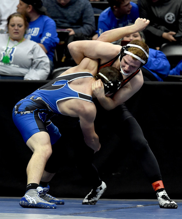 . Colton Eberhardt, of Lamar, right, takes on Elias Peroulis, of Moffat County, during the Colorado Wrestling State Championships finals on February 18, 2017. For more photos, go to www.BoCoPreps.com. Cliff Grassmick / Staff Photographer / February 18, 2017