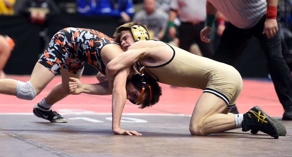 . Cole Polluconi, right, of Monarch, takes on Tyren Castonguay, of Grand Junction,during the Colorado Wrestling State Championships finals on February 18, 2017. For more photos, go to www.BoCoPreps.com. Cliff Grassmick / Staff Photographer / February 18, 2017