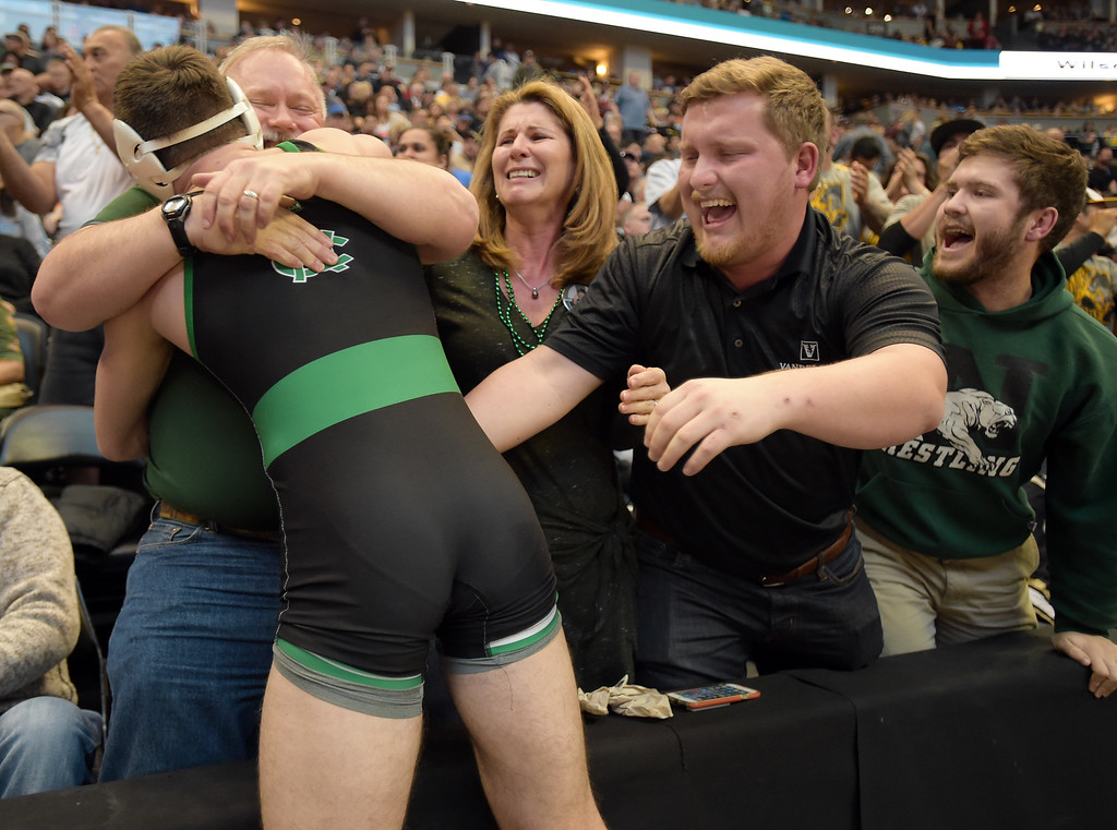 . From left: Niwot\'s Tommy Stager celebrates with his father Mark, mother Barb, and brothers Luke and Nick after winning the 4A 145 pound championship during the state wrestling tournament at the Pepsi Center Saturday. To view more photos visit bocopreps.com. Lewis Geyer/Staff Photographer Feb. 18, 2017