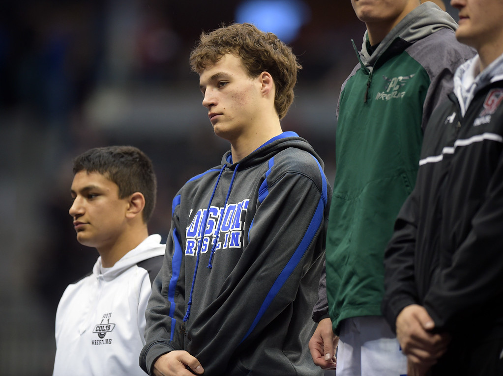 . Longmont\'s Drake Engelking stands on the medal stand after his third place finish in the 4A 160 pound class during the state wrestling tournament at the Pepsi Center Saturday. To view more photos visit bocopreps.com. Lewis Geyer/Staff Photographer Feb. 18, 2017