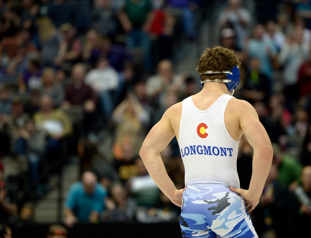 . Longmont\'s Nathan Morris stands in the center of the mat after losing in the championship 4A 152 match during the state wrestling tournament at the Pepsi Center Saturday. To view more photos visit bocopreps.com. Lewis Geyer/Staff Photographer Feb. 18, 2017
