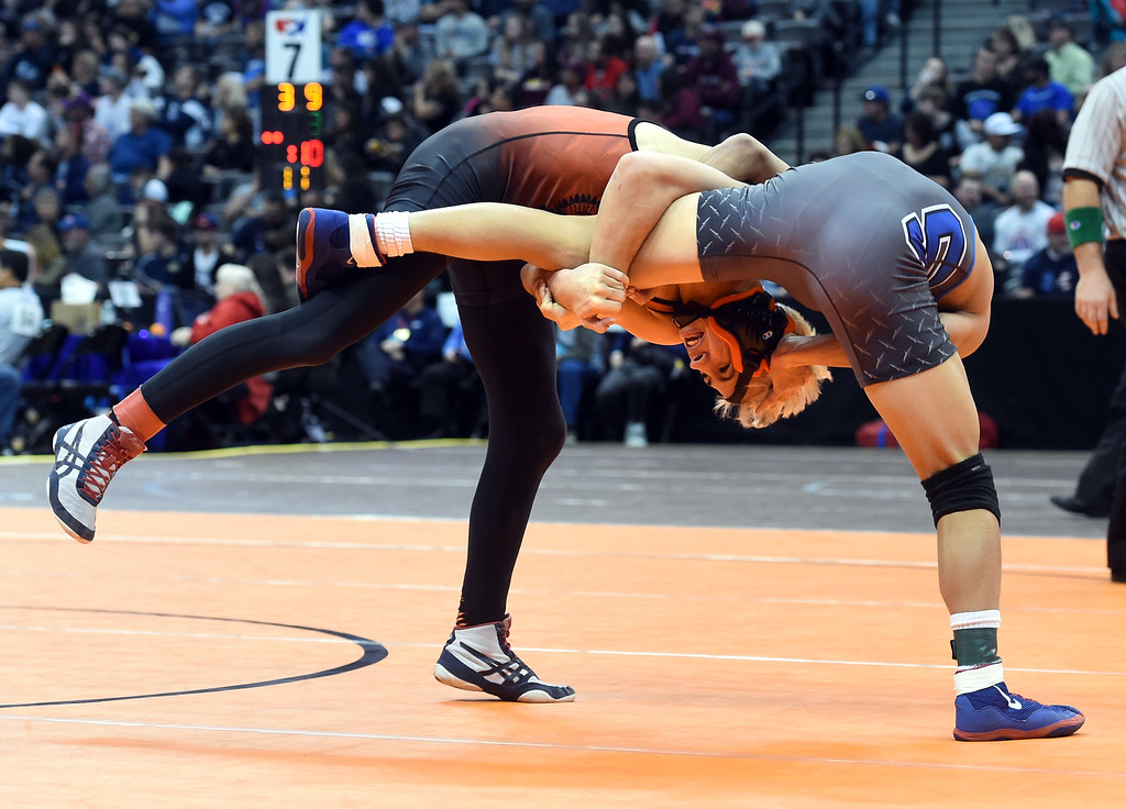 . Lamar\'s Ethan Andrade, left, takes on Presiliamo Maez, of Sheridan, at 3A 120-pounds, during the Colorado Wrestling State Championships finals on February 18, 2017. For more photos, go to www.BoCoPreps.com. Cliff Grassmick / Staff Photographer / February 18, 2017