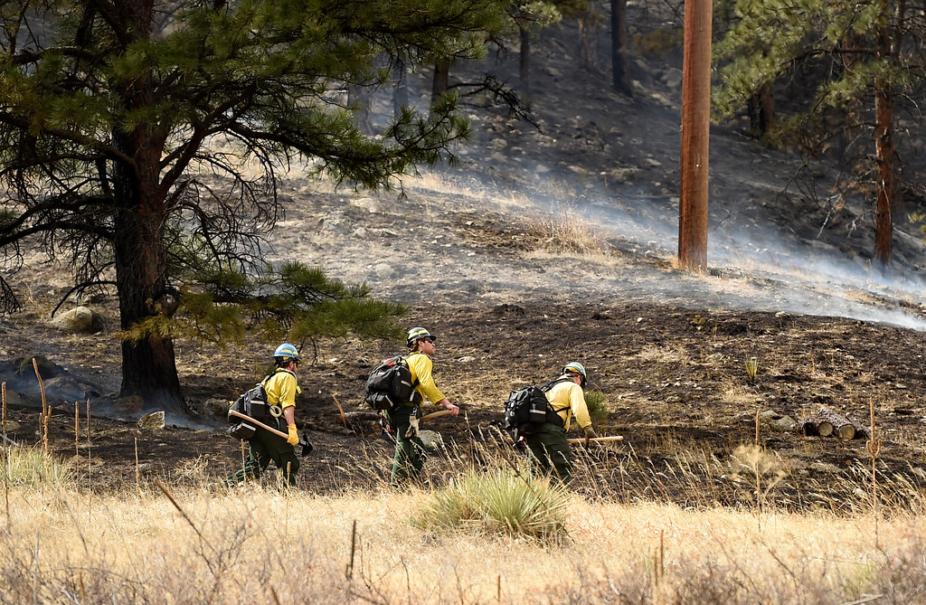 . Crews walk towards the fire as firefighters battle the Sunshine Fire in the Sunshine canyon area of Boulder, Colo. on Sunday, March 19. For more photos of the Sunshine Fire go to www.dailycamera.com Jeremy Papasso/ Staff Photographer/ March 19, 2017