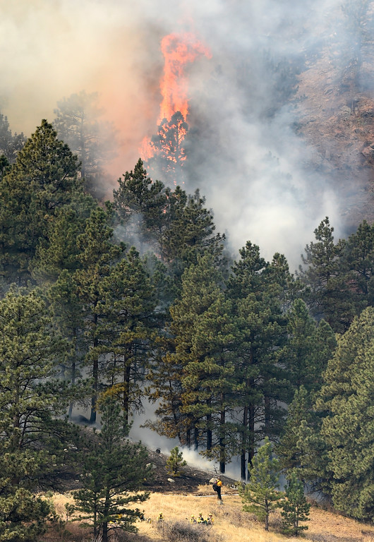 . Fire rages as crews battle the Sunshine Fire in the Sunshine canyon area of Boulder, Colo. on Sunday, March 19. For more photos of the Sunshine Fire go to www.dailycamera.com Jeremy Papasso/ Staff Photographer/ March 19, 2017