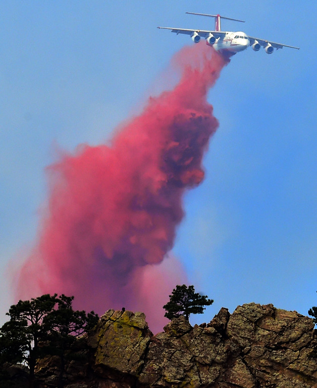 . A slurry bomber drops on the Sunshine Fire west of Boulder on Sunday  Paul Aiken Staff Photographer March 19 2017