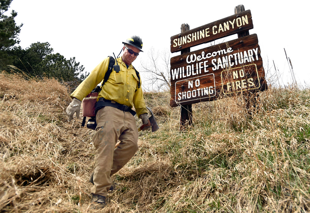 . Lefthand Fire District Chief Steve Lynn walks back to get supplies as crews battle the Sunshine Fire in the Sunshine canyon area of Boulder, Colo. on Sunday, March 19. For more photos of the Sunshine Fire go to www.dailycamera.com Jeremy Papasso/ Staff Photographer/ March 19, 2017