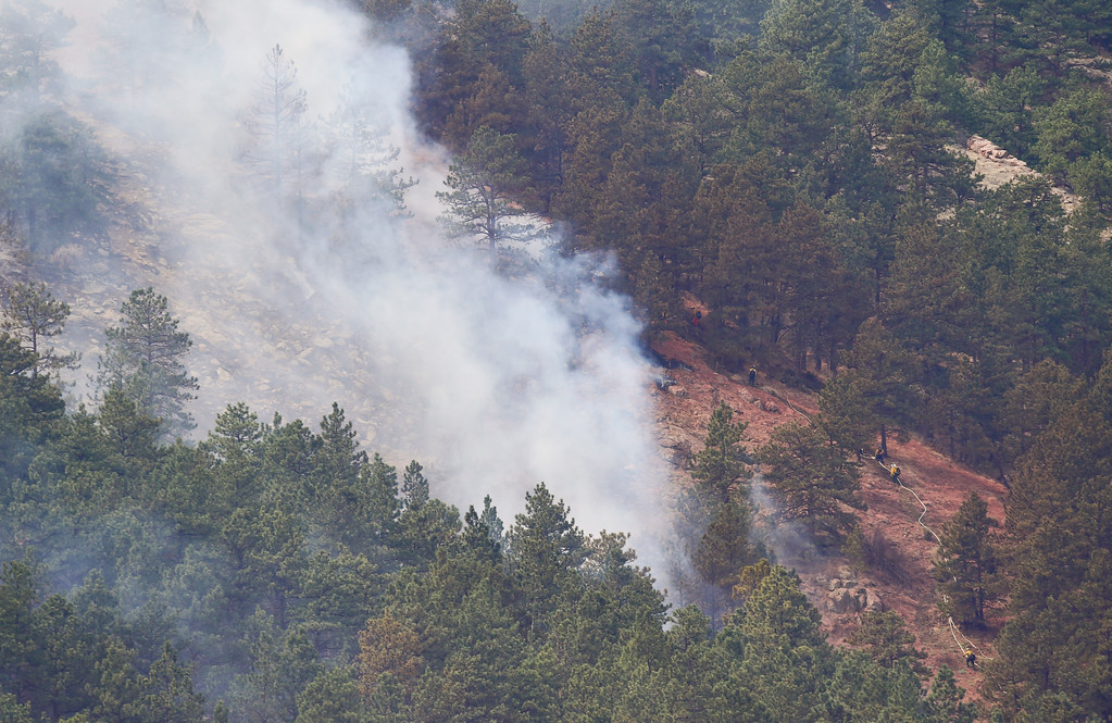 . Wildland Fire Crews work to contain the fire in Sunshine Canyon west of Boulder on Sunday. More photos: DailyCamera.com. Matthew Jonas/Staff Photographer March 19,  2017