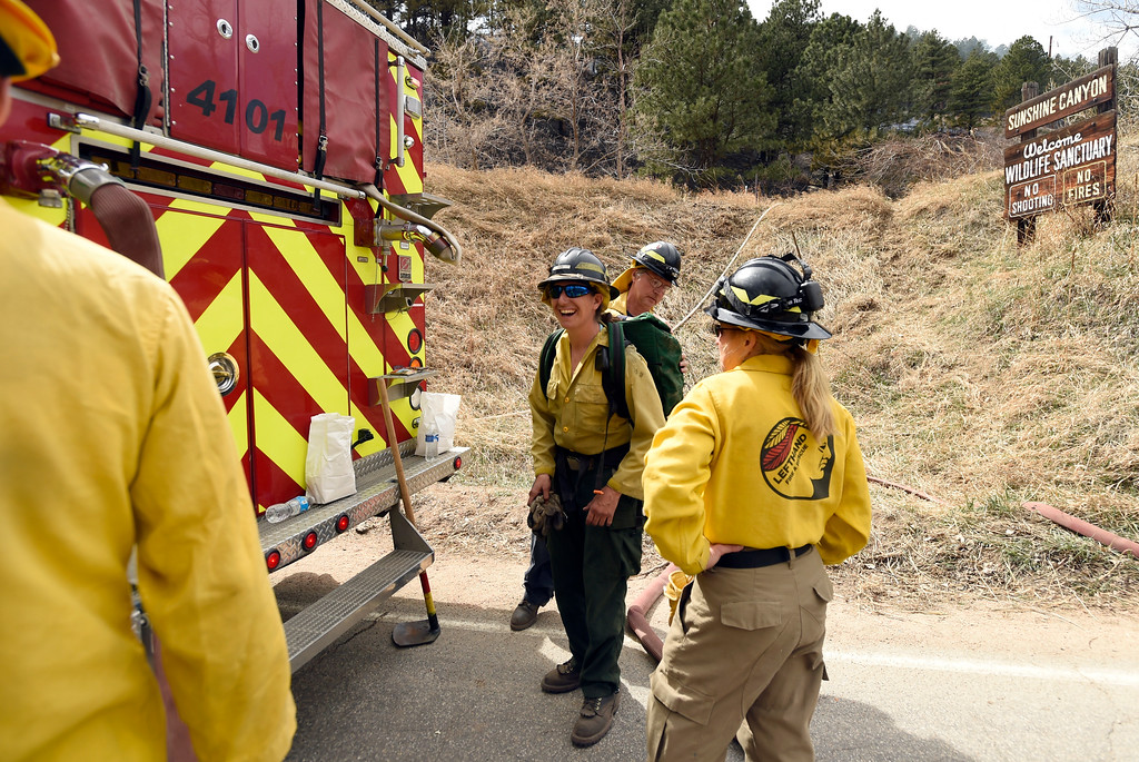 . Lefthand Fire District firefighters including Melissa Friess, at center, load supplies to take to crews battling the Sunshine Fire in the Sunshine canyon area of Boulder, Colo. on Sunday, March 19. For more photos of the Sunshine Fire go to www.dailycamera.com Jeremy Papasso/ Staff Photographer/ March 19, 2017