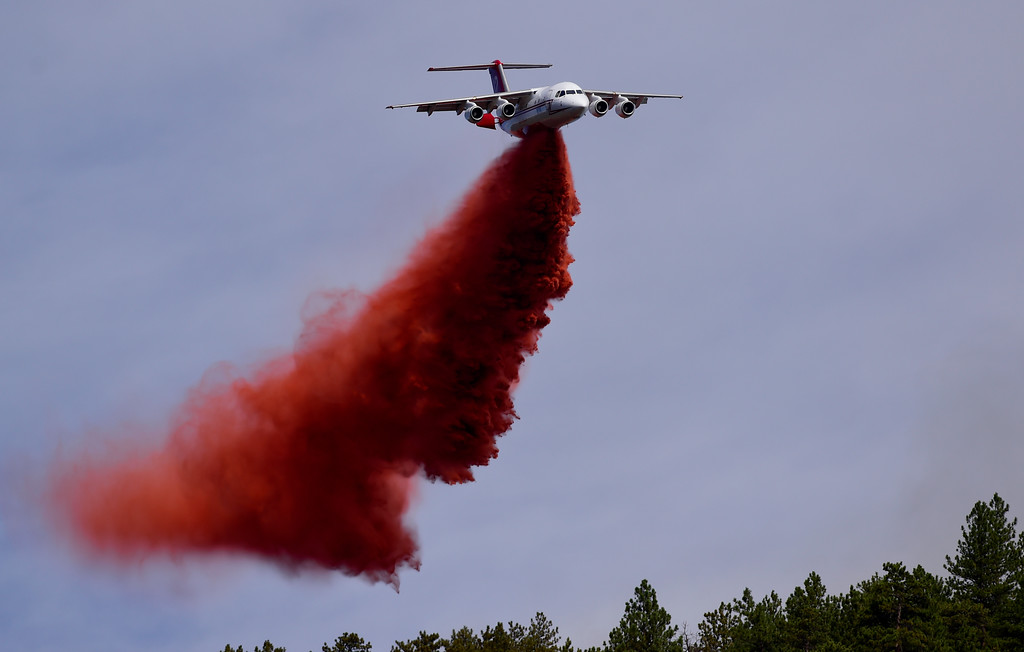 . A slurry bomber drops fire retardant on the Sunshine Canyon fire in Boulder on Sunday. More photos: DailyCamera.com. Matthew Jonas/Staff Photographer March 19,  2017
