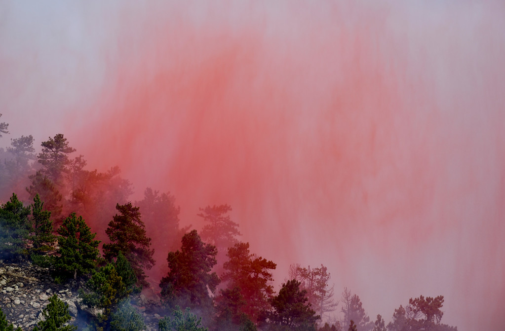 . A plume of red fire retardant is seen after being dropped from a slurry bomber on the Sunshine Canyon fire on Sunday. More photos: DailyCamera.com. Matthew Jonas/Staff Photographer March 19,  2017