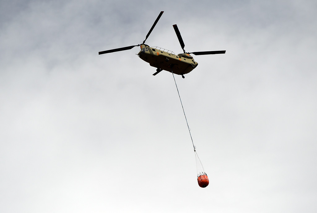 . A helicopter drops water on a hotspot while crews battle the Sunshine Fire in the Sunshine canyon area of Boulder, Colo. on Sunday, March 19. For more photos of the Sunshine Fire go to www.dailycamera.com Jeremy Papasso/ Staff Photographer/ March 19, 2017