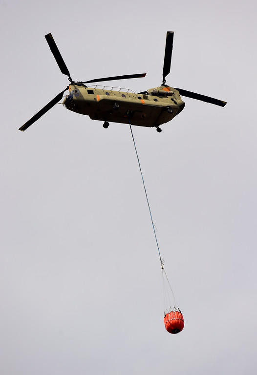 . A Colorado National Guard chinook helicopter circled but didn\'t make a water drop on the fire in Sunshine Canyon west of Boulder on Sunday. More photos: DailyCamera.com. Matthew Jonas/Staff Photographer March 19,  2017