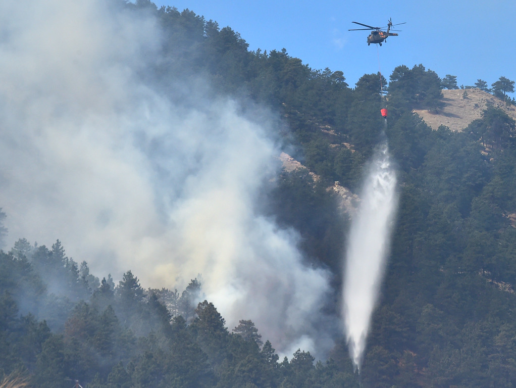 . A helicopter drops water on the Sunshine Fire west of Boulder on Sunday  Paul Aiken Staff Photographer March 19 2017
