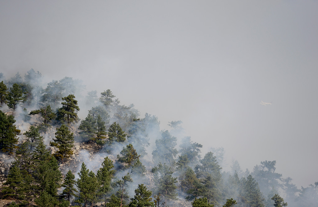 . Smoke rises from the fire in Sunshine Canyon in Boulder on Sunday. More photos: DailyCamera.com. Matthew Jonas/Staff Photographer March 19,  2017