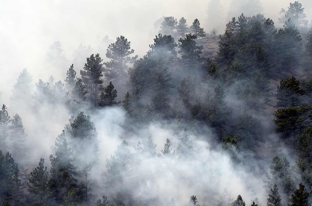 . Fire rages crews battle the Sunshine Fire in the Sunshine canyon area of Boulder, Colo. on Sunday, March 19. For more photos of the Sunshine Fire go to www.dailycamera.com Jeremy Papasso/ Staff Photographer/ March 19, 2017