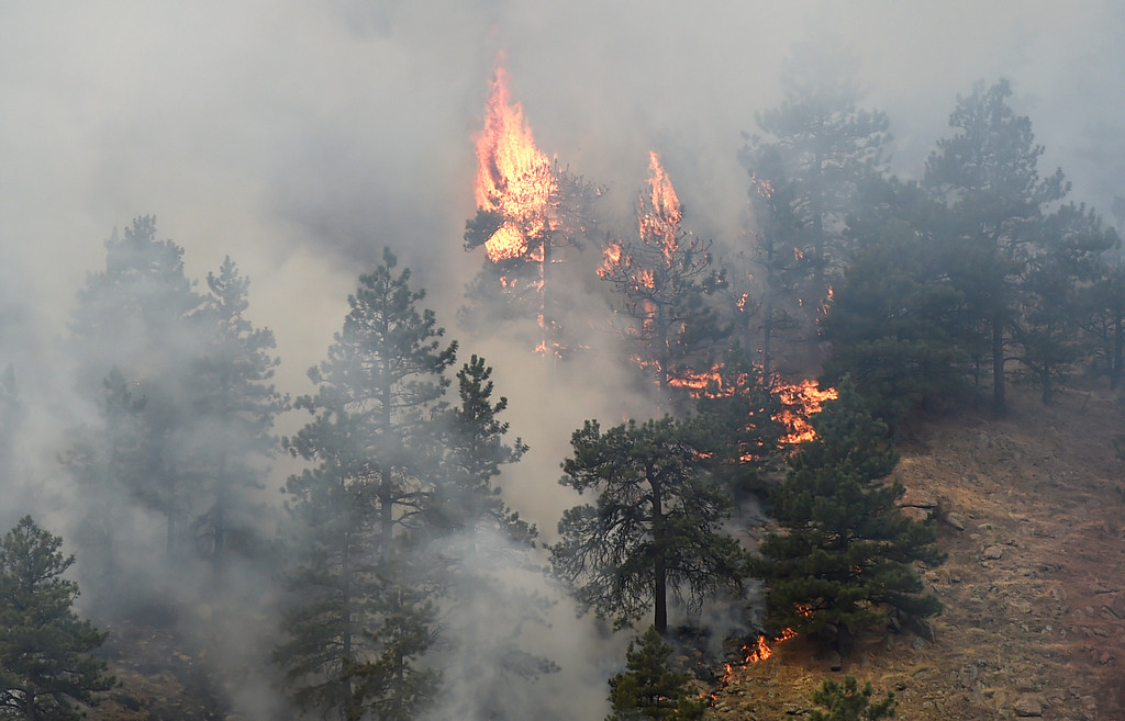 . Fire burns while crews battle the Sunshine Fire in the Sunshine canyon area of Boulder, Colo. on Sunday, March 19. For more photos of the Sunshine Fire go to www.dailycamera.com Jeremy Papasso/ Staff Photographer/ March 19, 2017