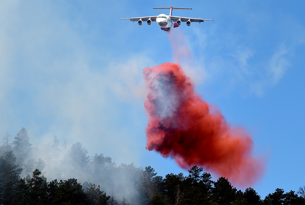. An airplane drops fire retardant as crews battle the Sunshine Fire in the Sunshine canyon area of Boulder, Colo. on Sunday, March 19. For more photos of the Sunshine Fire go to www.dailycamera.com Jeremy Papasso/ Staff Photographer/ March 19, 2017